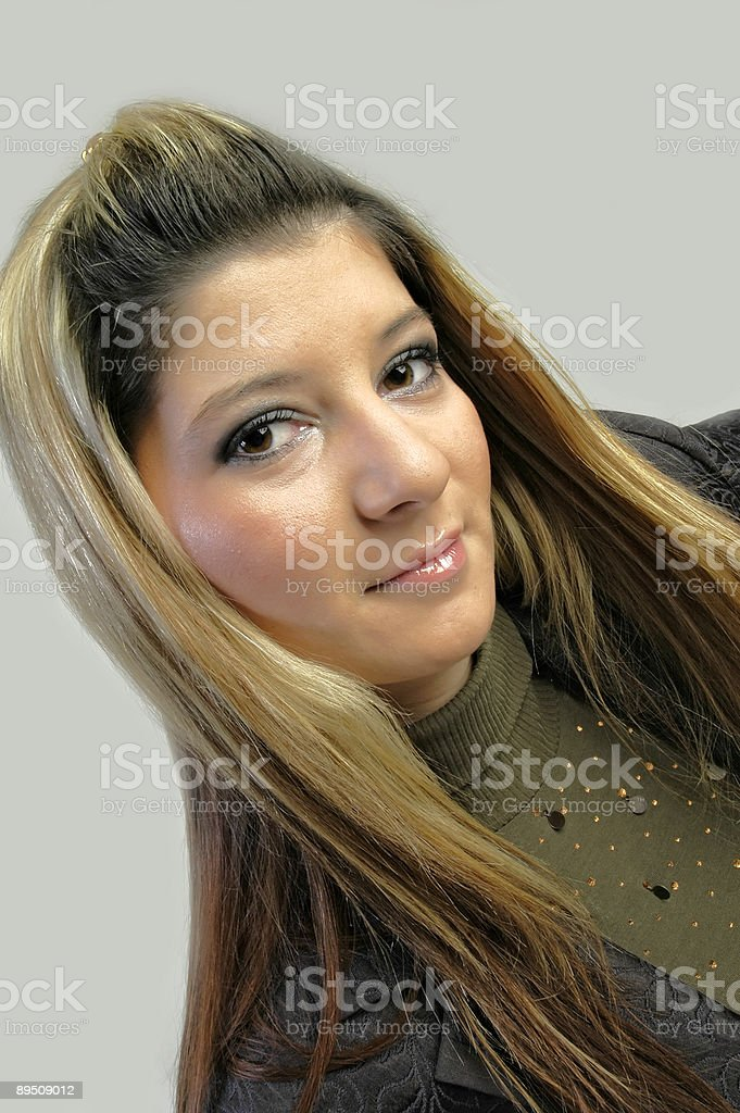 Cute woman with long hair posing royalty-free stock photo