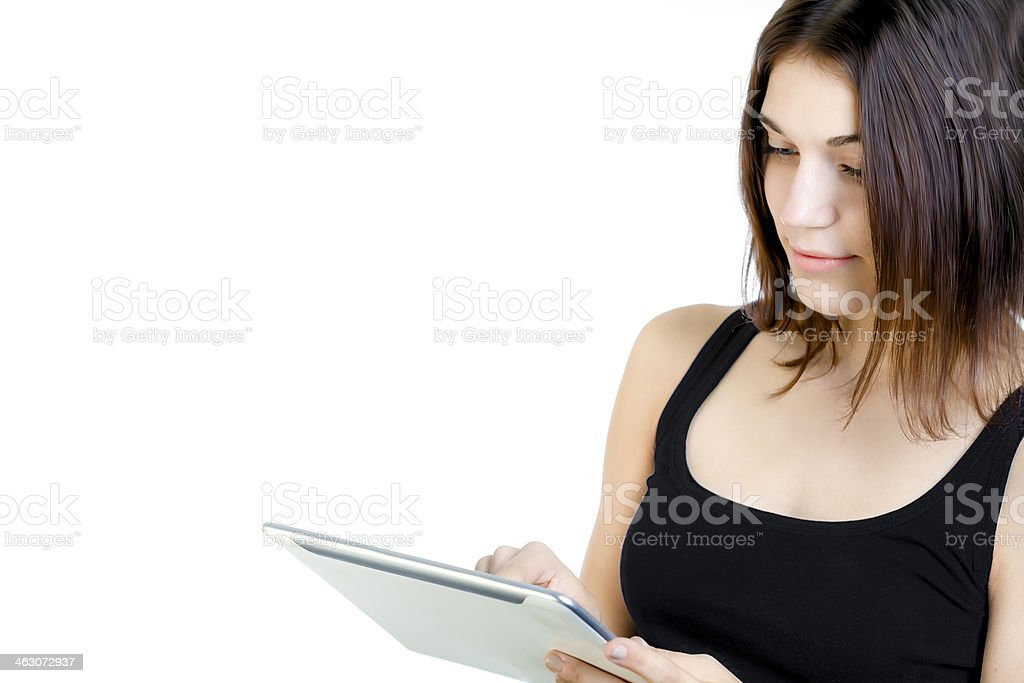 Cute Younf Woman Using a Tablet royalty-free stock photo