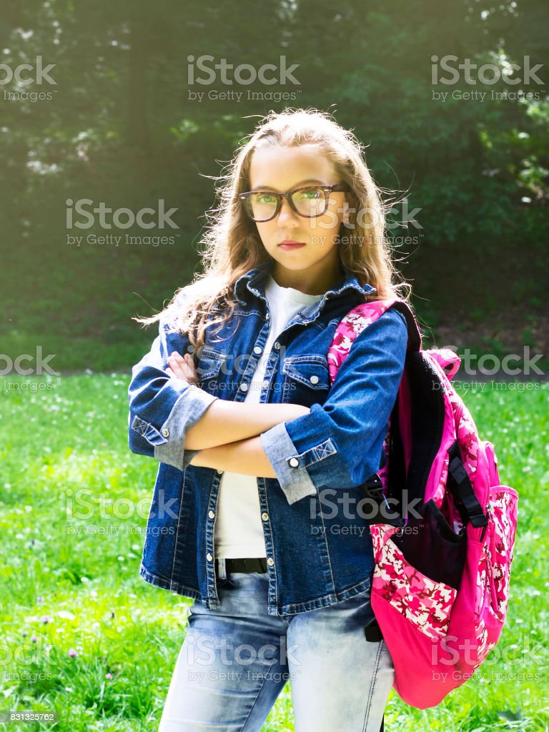 Cute Young Blonde Schoolgirl With Glasses And Denim Shirt Royalty Free Stock Photo