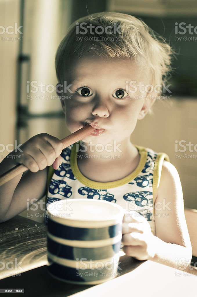 Cute Young Boy Eating Rhubarb Dipped in Sugar royalty-free stock photo
