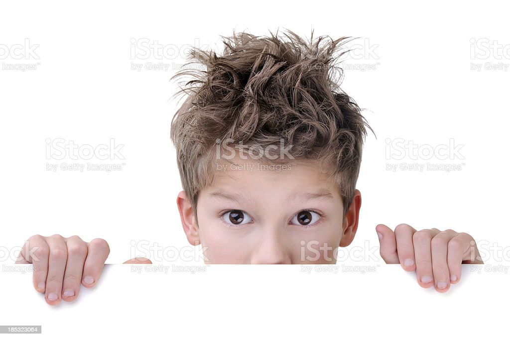 Cute Young Boy Hiding Behind An Empty Placard royalty-free stock photo