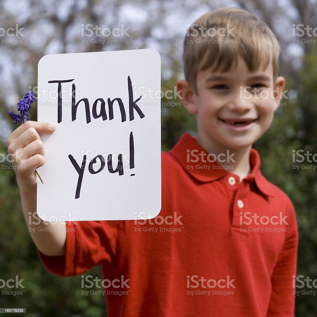 Cute Young Boy Holding a Thank You Sign stock photo