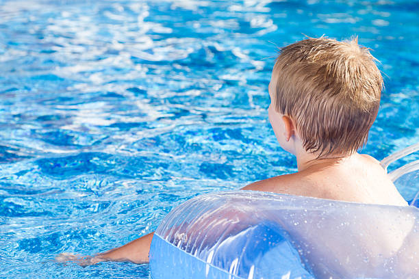 Cute Young Boy in Water stock photo
