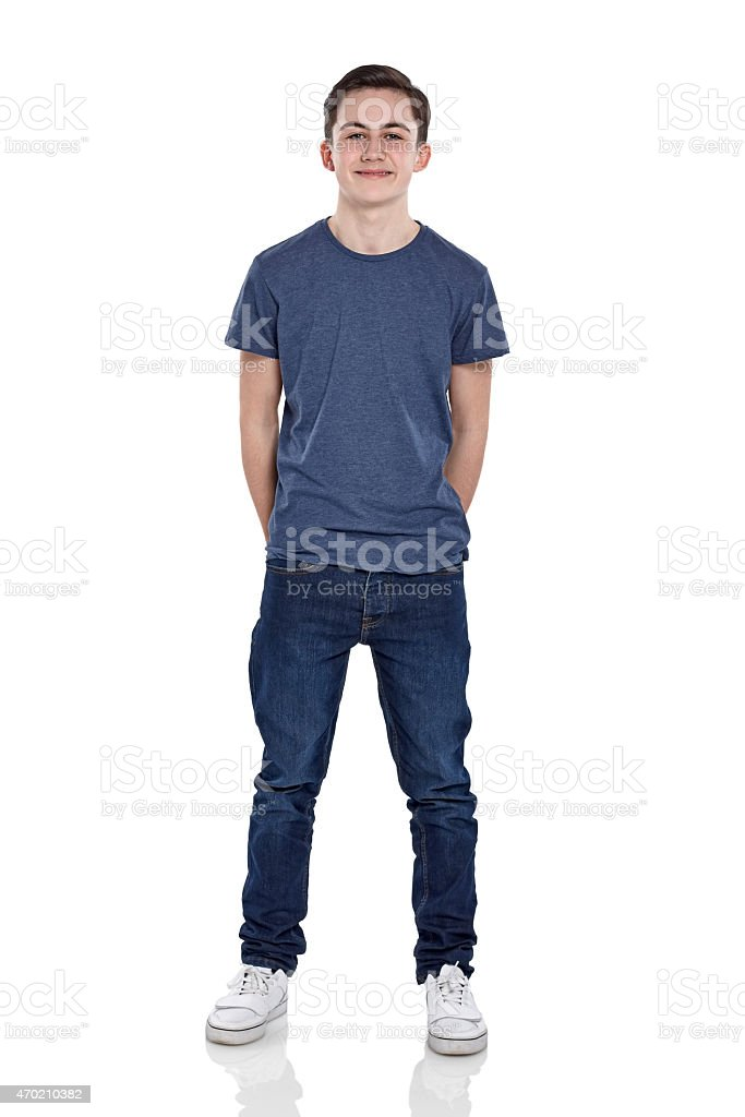 Cute young boy looking at camera smiling stock photo