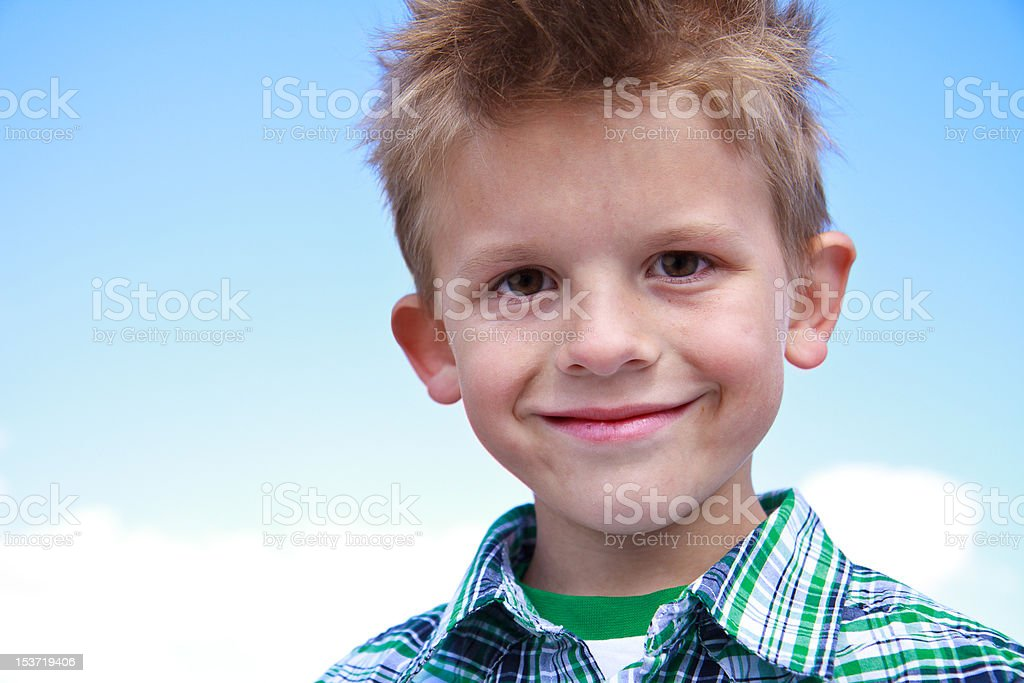 Cute young boy smiling at the viewer stock photo