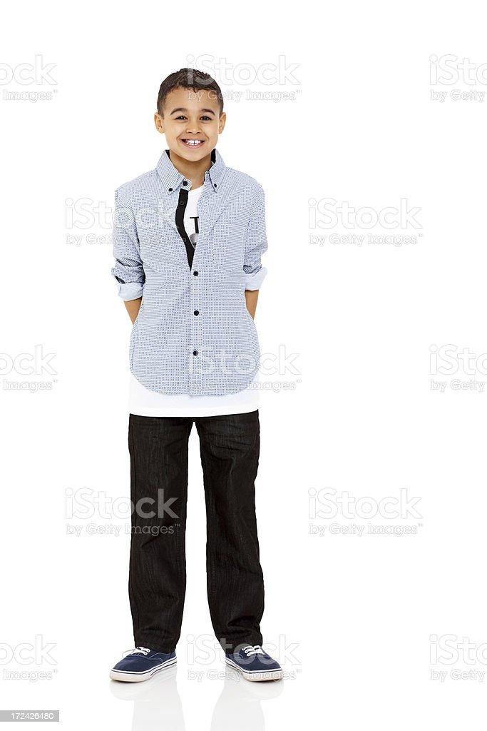 Cute young boy standing on white stock photo