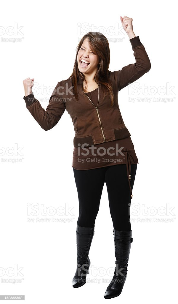 Cute young brunette stands and cheers, fists clenched royalty-free stock photo