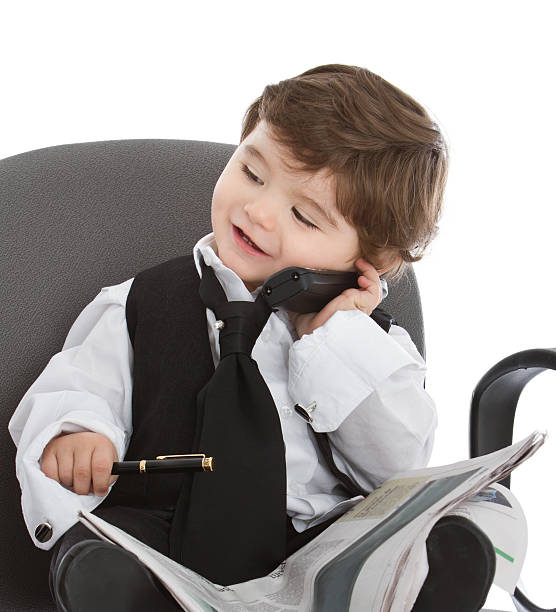 Cute young businessman at phone stock photo