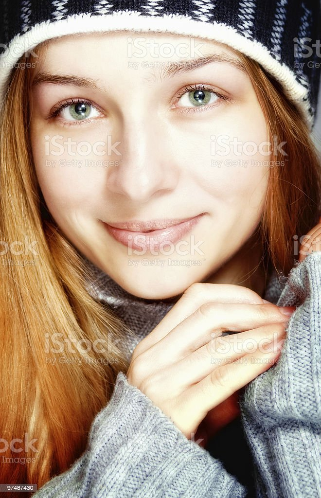 Cute young content woman in winter clothes royalty-free stock photo