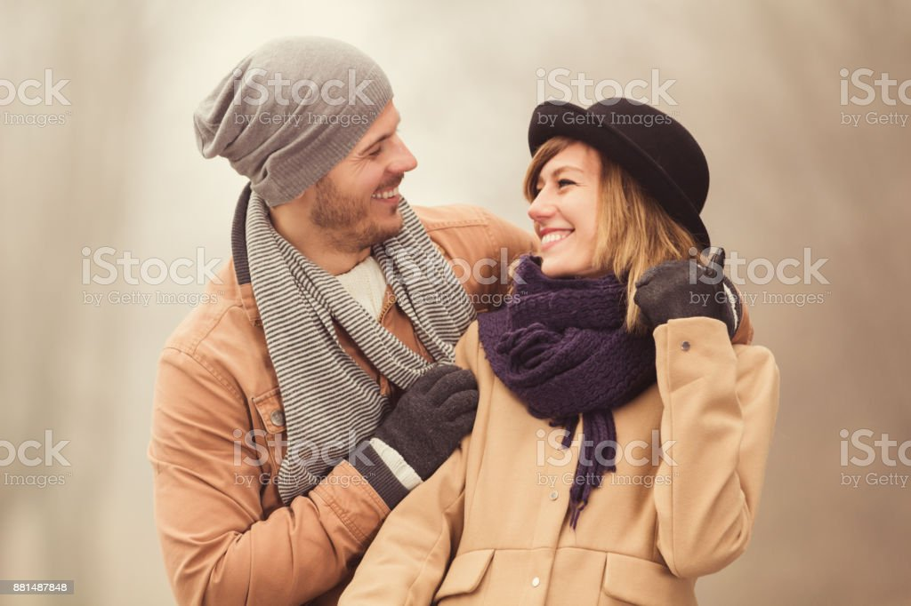 Cute young couple enjoying the cold weather outdoors. stock photo
