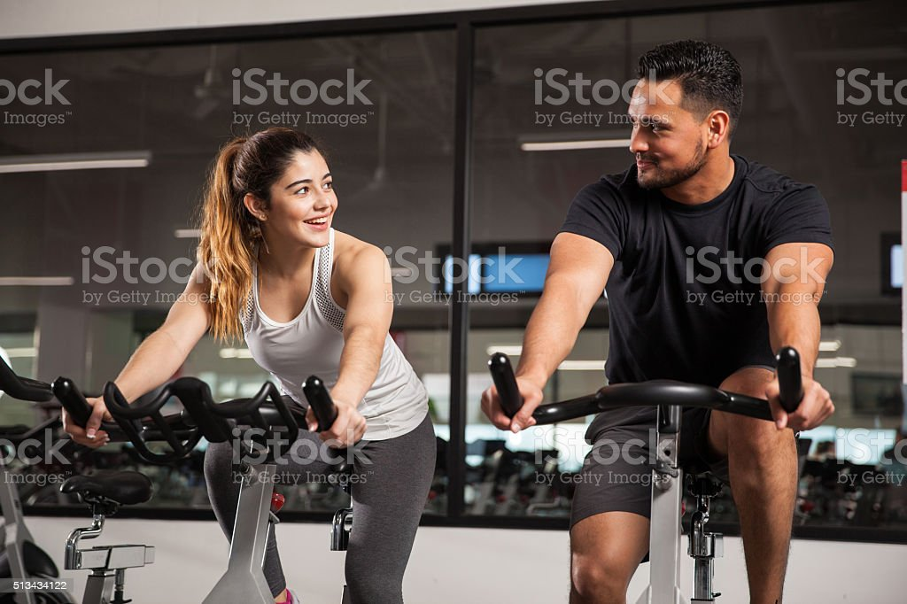 Cute young couple flirting at a gym stock photo