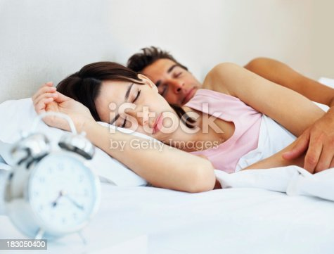Cute Young Couple Sleeping Together On Bed At Home Stock Photo & More Pictures of 20-29 Years