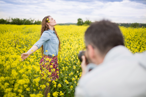 Cute young couple taking photos.