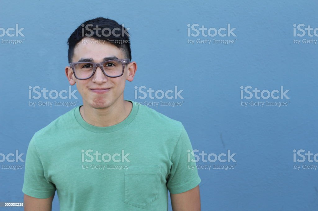 Cute young ethnic male with glasses stock photo