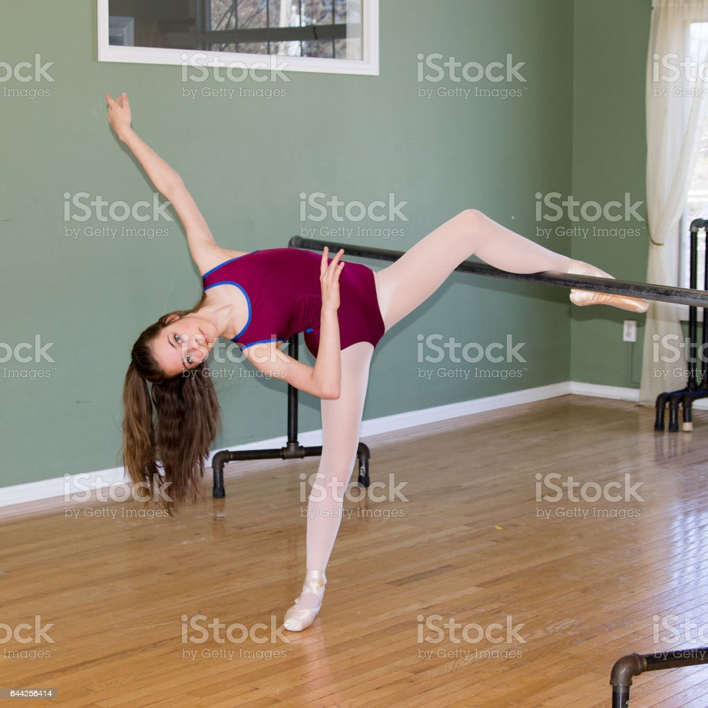 Cute young female ballerina dancing in studio stock photo
