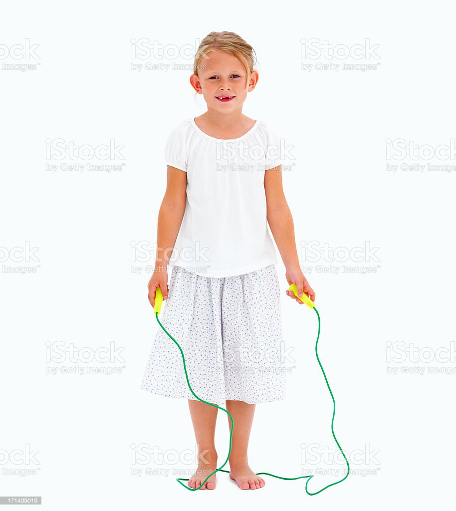 Cute young girl holding skipping rope royalty-free stock photo