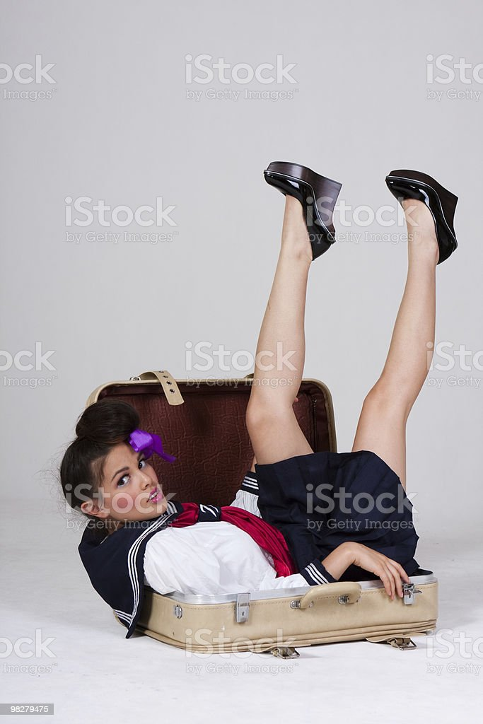 Cute young girl in a suitcase royalty-free stock photo