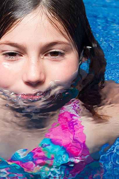 Cute Young Girl in Water stock photo