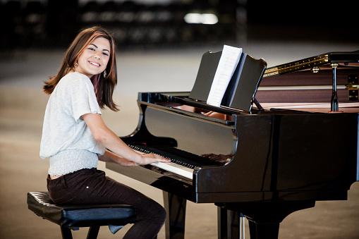Cute Young Girl Playing Piano
