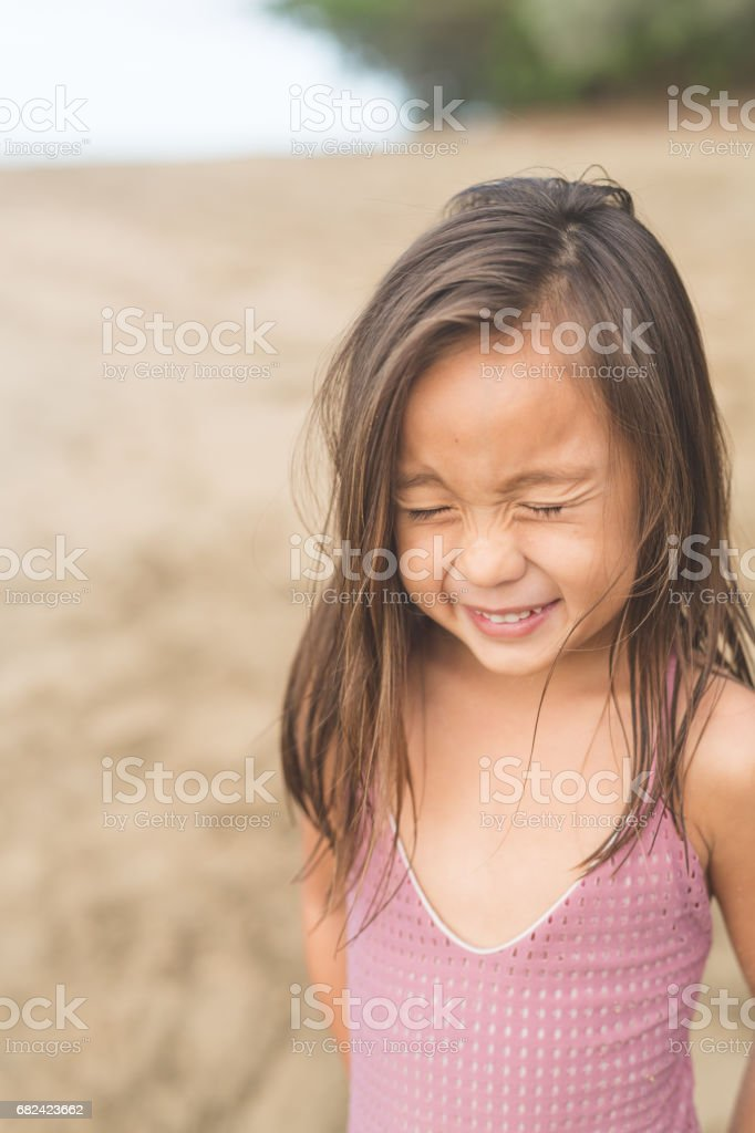 Cute young girl posing for camera on Hawaii beach royalty-free stock photo