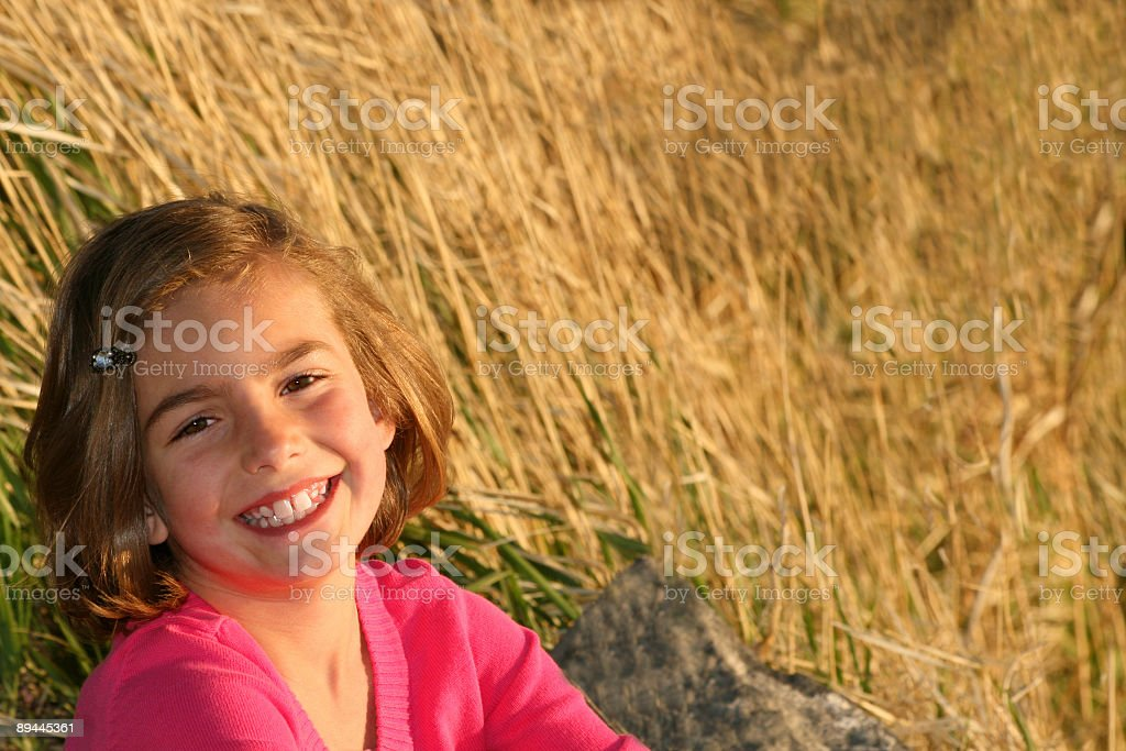Cute young girl smiling royalty-free stock photo