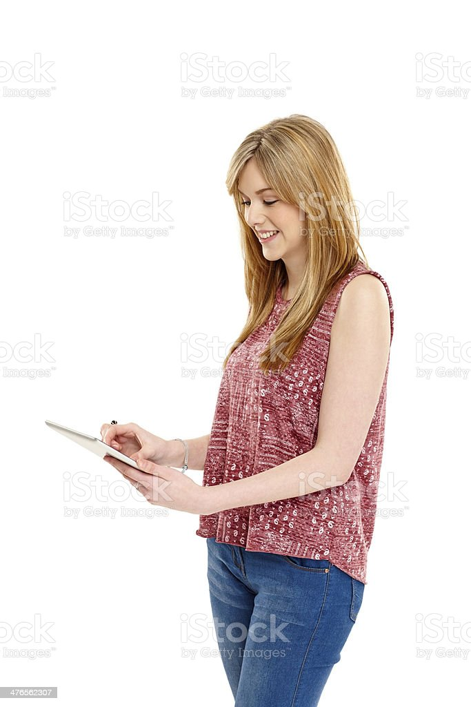 Cute young lady using digital tablet royalty-free stock photo