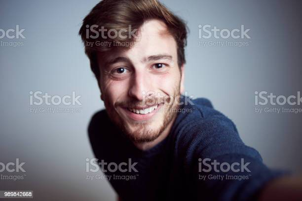 Cute young male looking at camera and smiling in the studio real a picture id989842668?b=1&k=6&m=989842668&s=612x612&h=z4tclk4nk dv3kjjkkim46ttcy0jzc wvqgeo8vpupg=