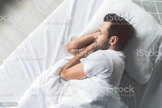 Cute young man sleeping on bed picture id860614794?b=1&k=6&m=860614794&s=612x612&h=uteiansb4decokwhbpvuaywx9a6ih4rfrpsvshs2cla=