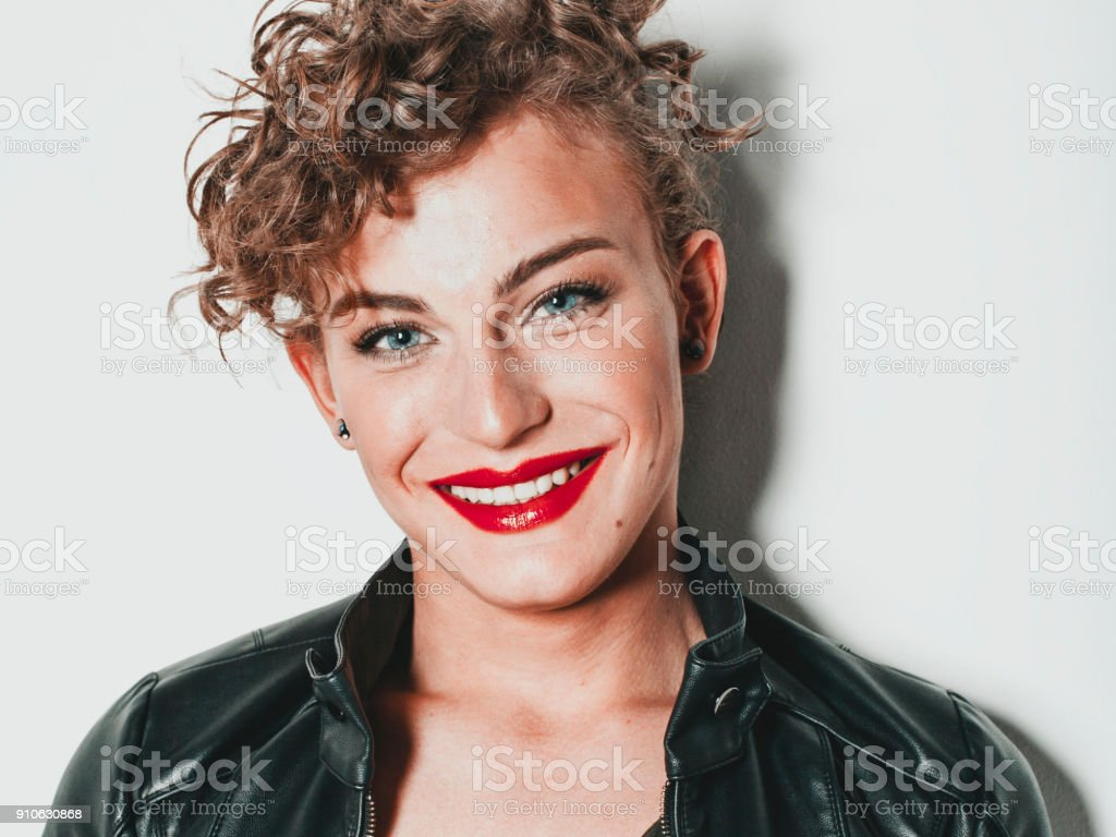 Cute young man smiling, make-up stock photo