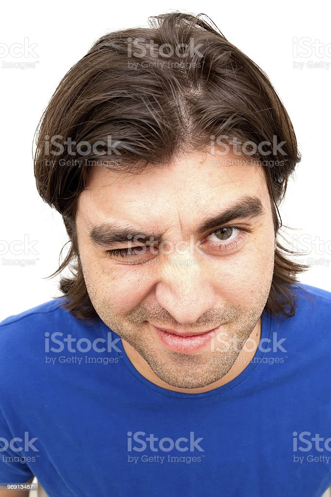 Cute young man winking royalty-free stock photo