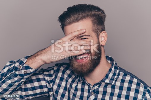 636829300 istock photo cute  young man with beard hiding his face with palms 636830476