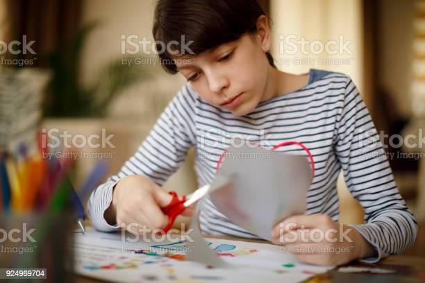 Girl Doing Homework And Contemplating Stock Photo - Thinkstock