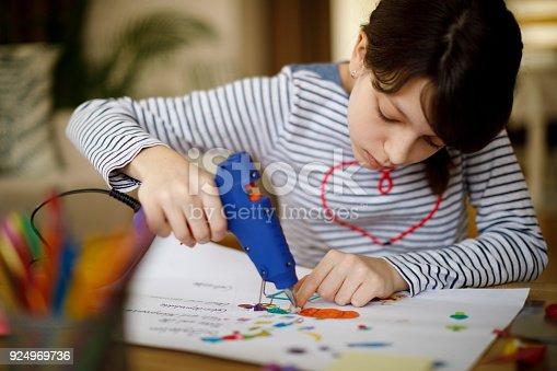 Cute young teenage girl doing homework project