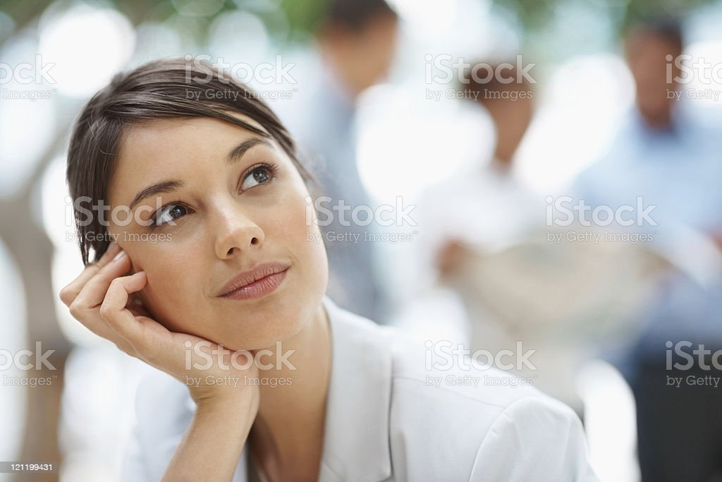 Cute young thoughtful business woman looking away royalty-free stock photo