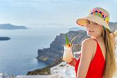 Cute young woman enjoying cocktail