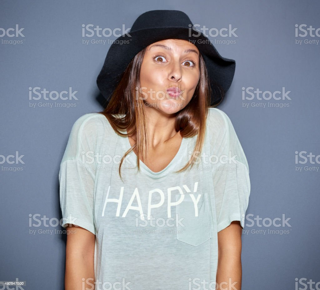 Cute young woman flirting with the camera stock photo