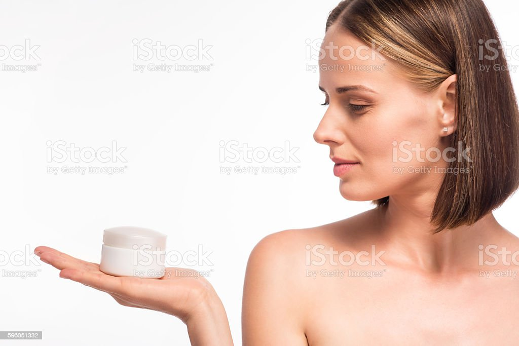 Cute young woman holding cosmetic royalty-free stock photo