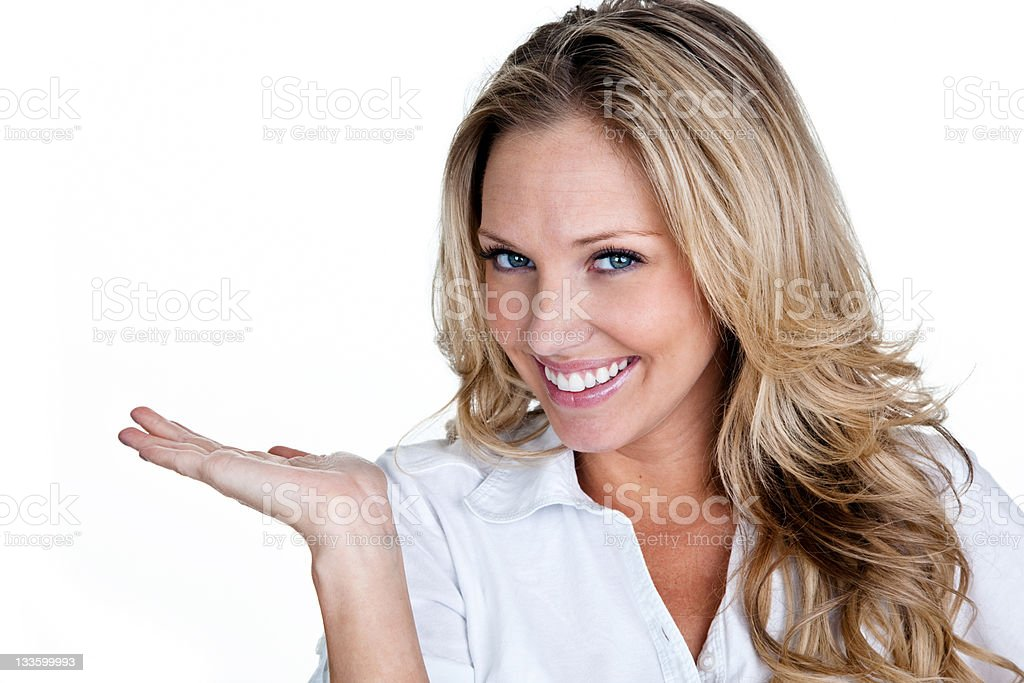 Cute young woman holding her hand up for copy space stock photo