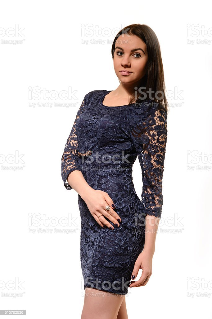 029fa14b3 Cute young woman in navy blue dress on white background royalty-free stock  photo
