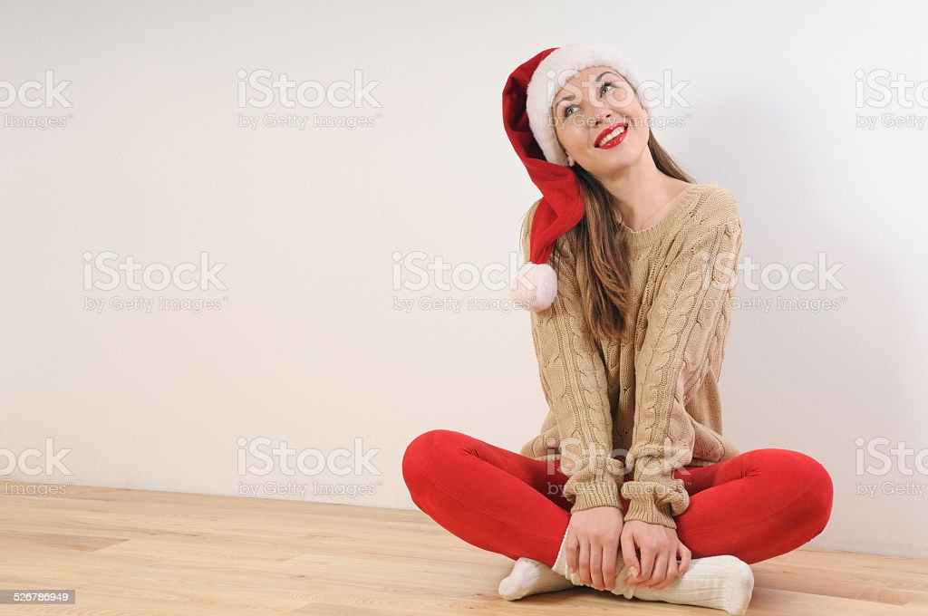 0ebd7c26cd4f6 Cute Young Woman In Santa Hat Dreaming Of Christmas Gift Stock Photo ...