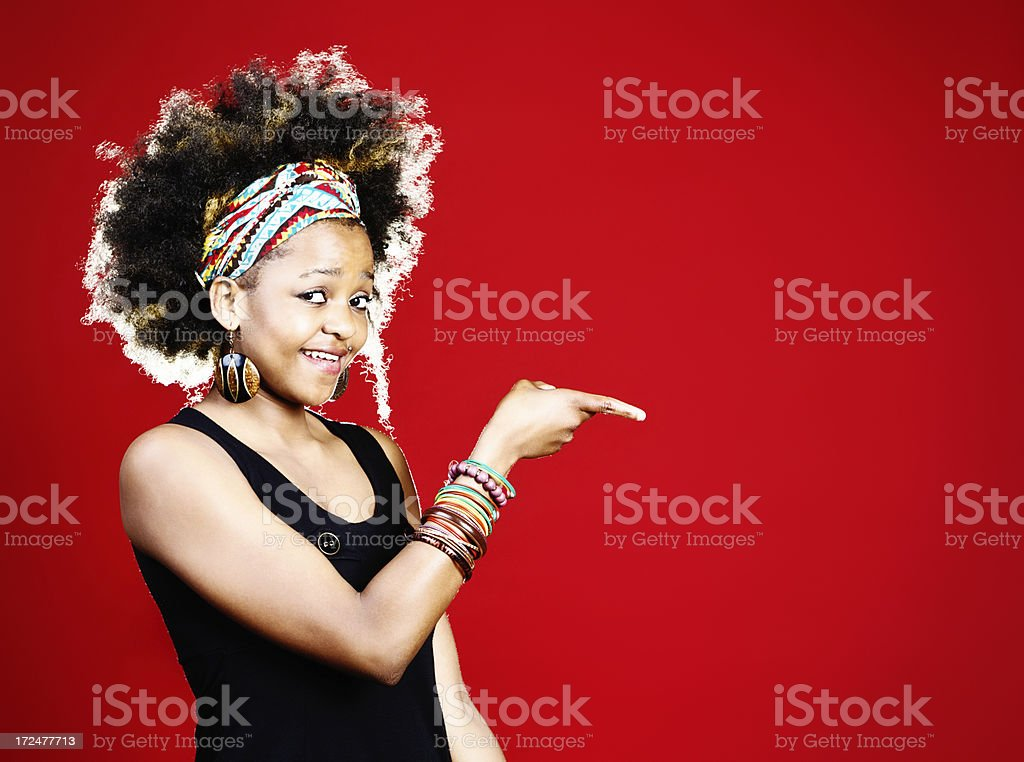 Cute young woman indicates space for your product or message royalty-free stock photo