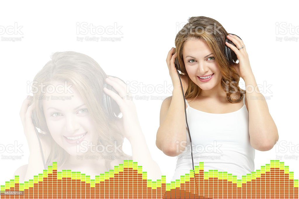 Cute young woman listens to headphones stock photo