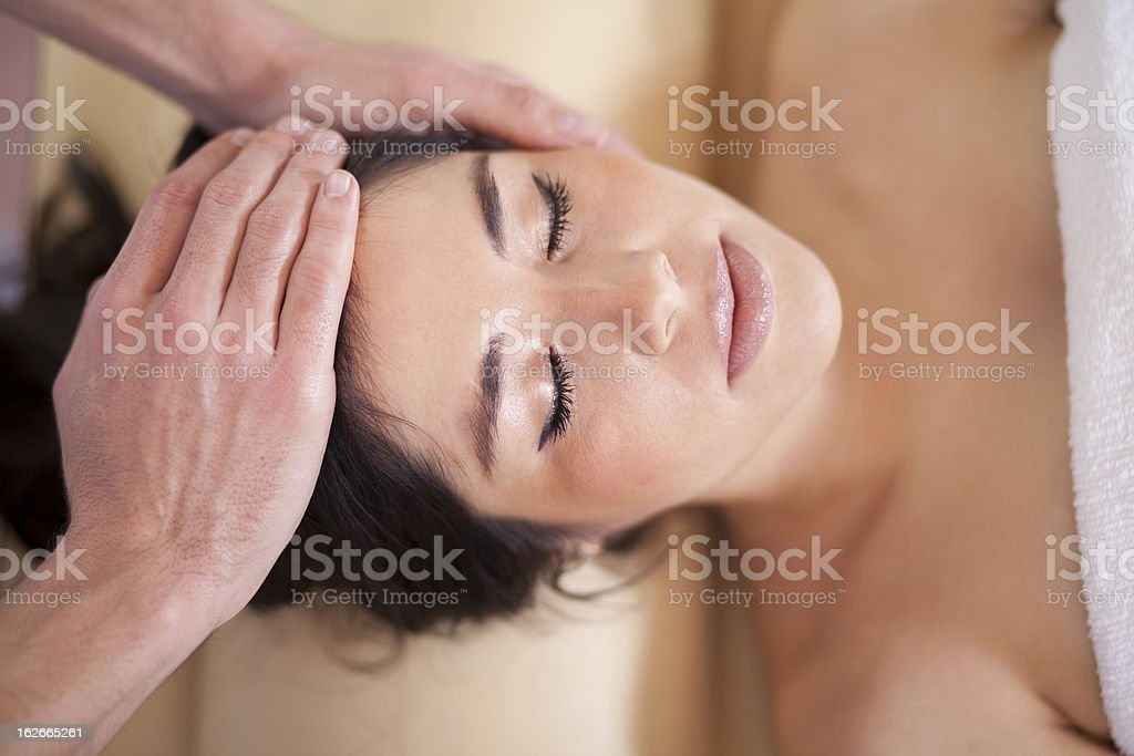 Cute young woman relaxing at a spa royalty-free stock photo