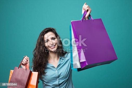 Foto de Cute Young Woman Shopping e mais banco de imagens de Abundância