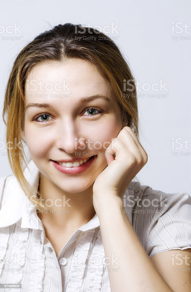 Cute young woman smiling royalty-free stock photo