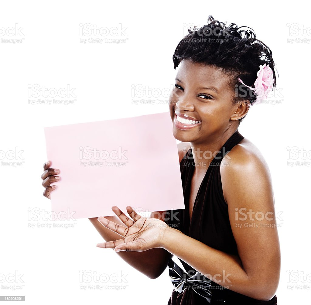 Cute young woman smilingly displays blank pink sign royalty-free stock photo