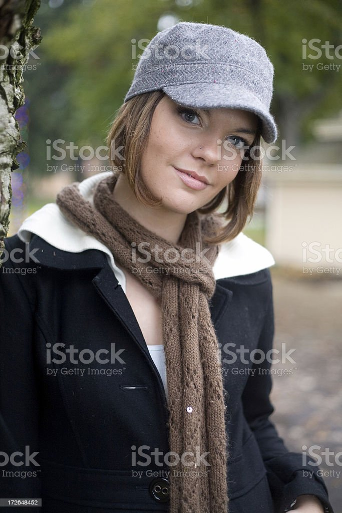 cute young woman wearing hat royalty-free stock photo