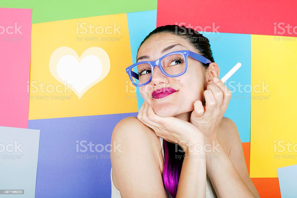 Cute Young Woman with Heart-shape stock photo