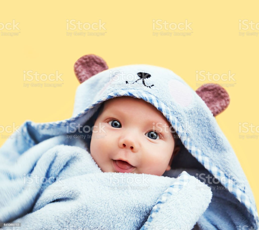 Cutest baby child after bath with towel on head stock photo