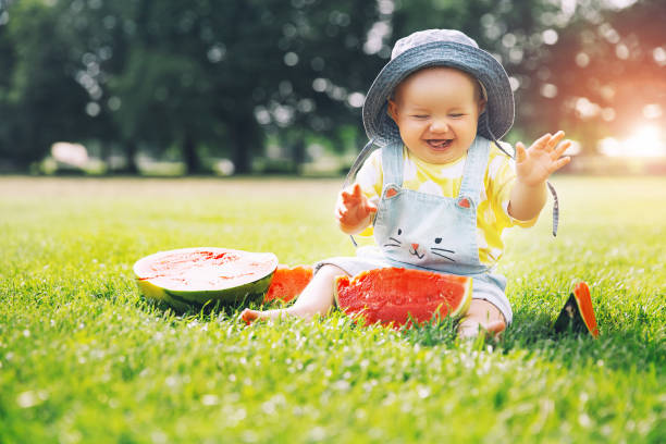 Cutest smiling baby girl eating watermelon on green grass in picture id971776996?b=1&k=6&m=971776996&s=612x612&w=0&h=rkqwbijmbsgm9p91qv5dowie7zw2xrlzwchqoqlft0y=